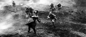 French soldiers on the battlefield, during an offensive action on the French fortress town of Verdun. A still from the 1928 film 'Verdun, Visions díHistoire', by Leon Poirier. (Photo by Hulton Archive/Getty Images)